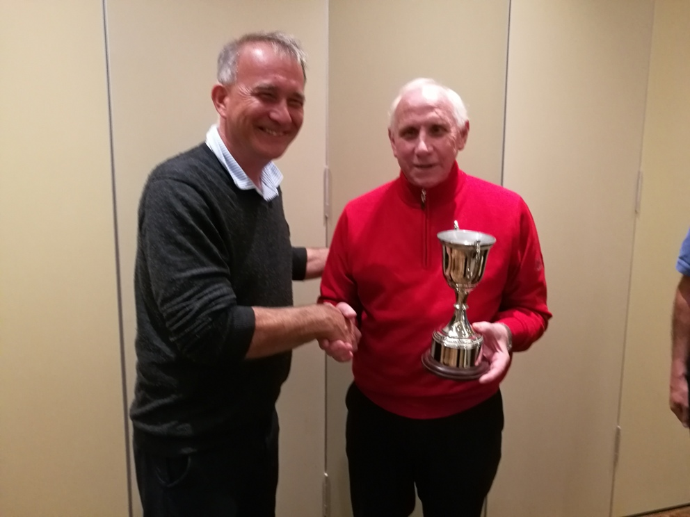 Image of Barry Ritchie being presented with the Stev Ford Trophy by Vice Captain John Eakin