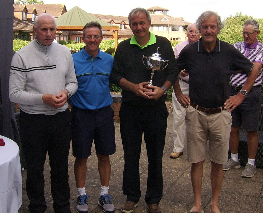An image of John Eakin accepting his trophy with his guide and also chairman Barry Ritchie
