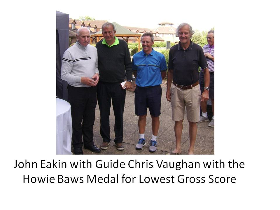 John Eakin with Guide Chris Vaughan and the Howie Baws Medal for Lowest Gross Score