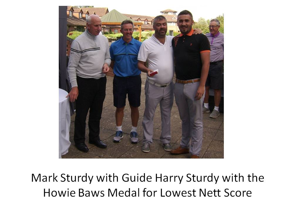 Mark Sturdy with guide Harry Sturdy and the Howie Baws Medal for Lowest Nett Score