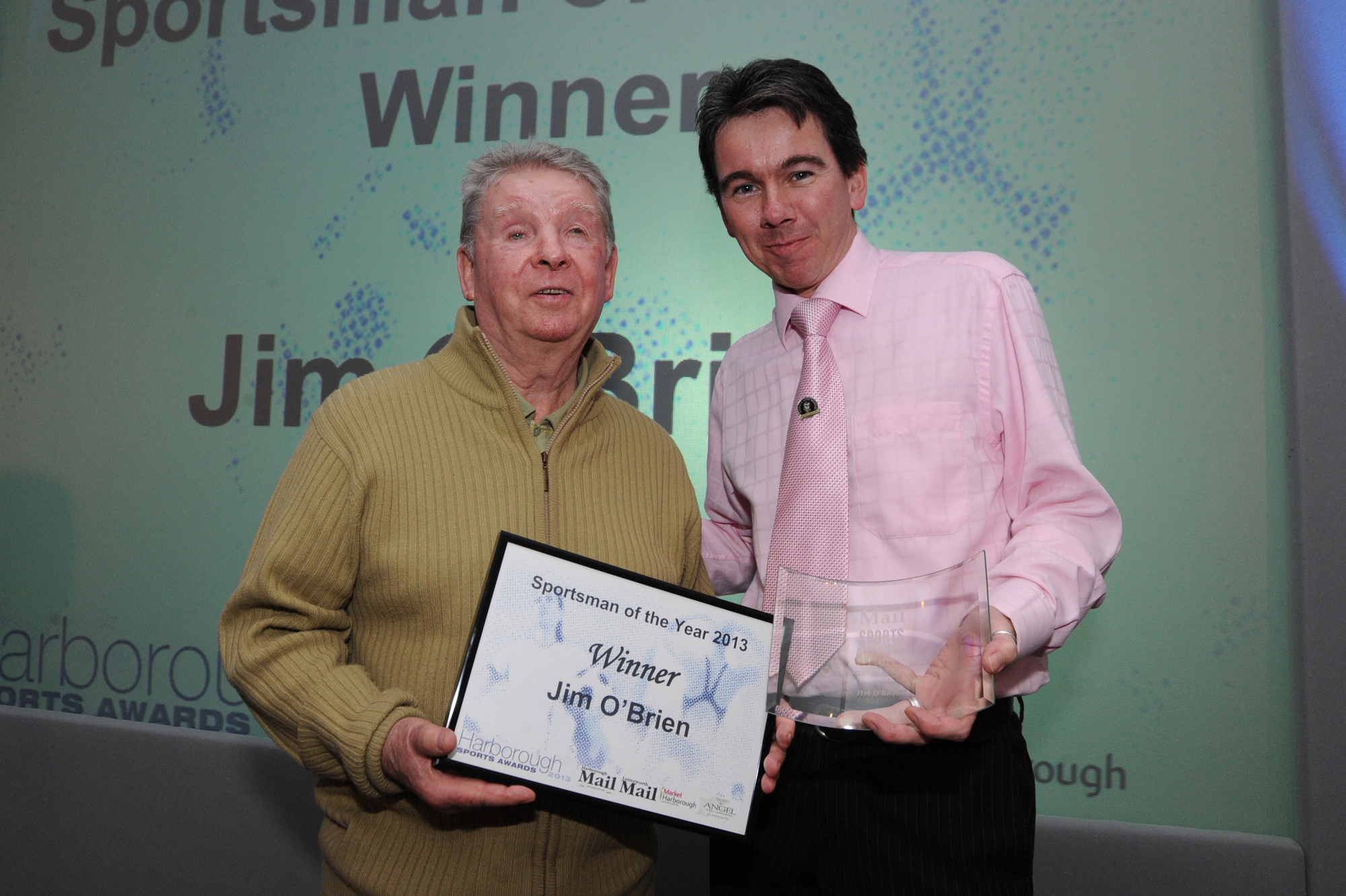 Jim is pictured with Darren Barton of award sponsors The Angel Hotel in Harborough